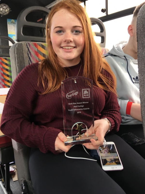 Nicole Vaughan on the bus home to Carrick-On-Suir with a Foróige Gold Star award