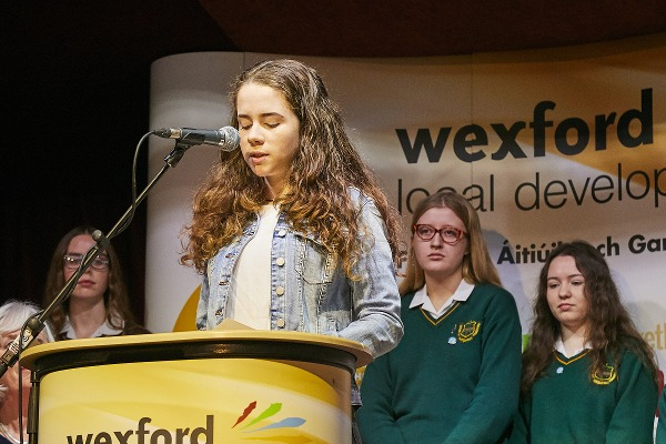 A female student addresses the audience at Wexford's Spiegeltent