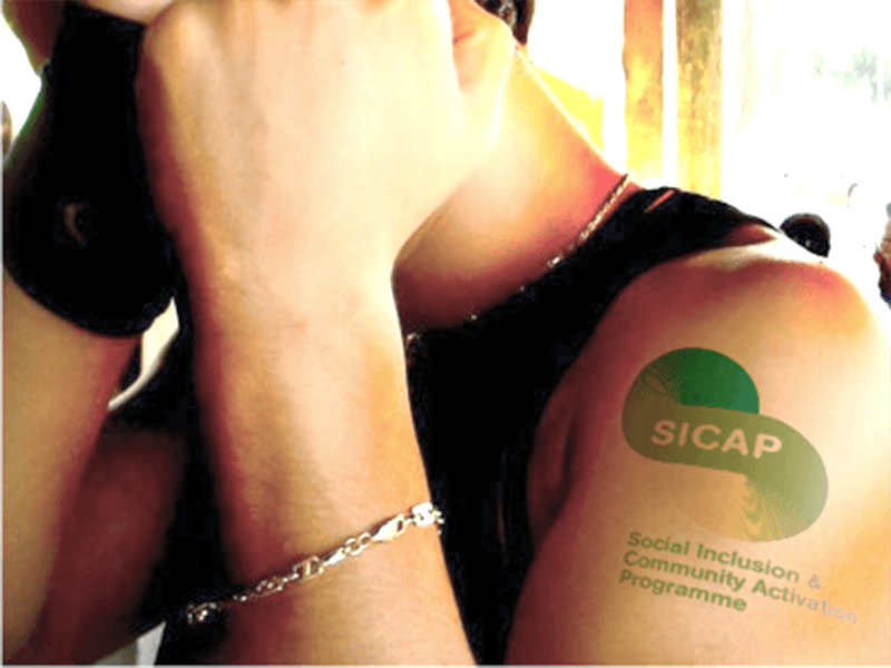 Citizen with SICAP logo tattoo