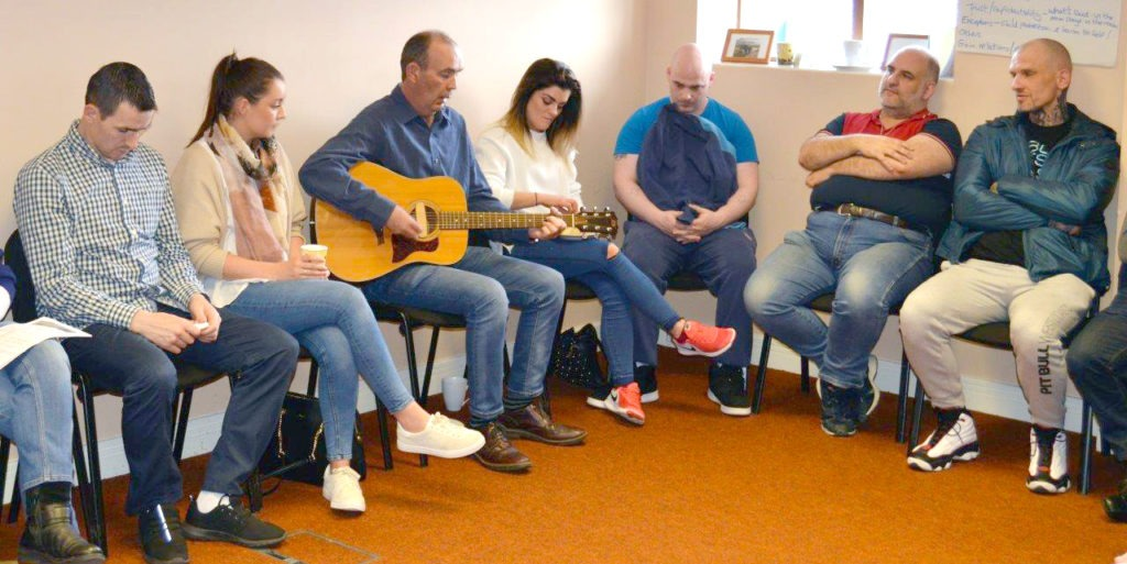 A group gathers at a Mojo meeting
